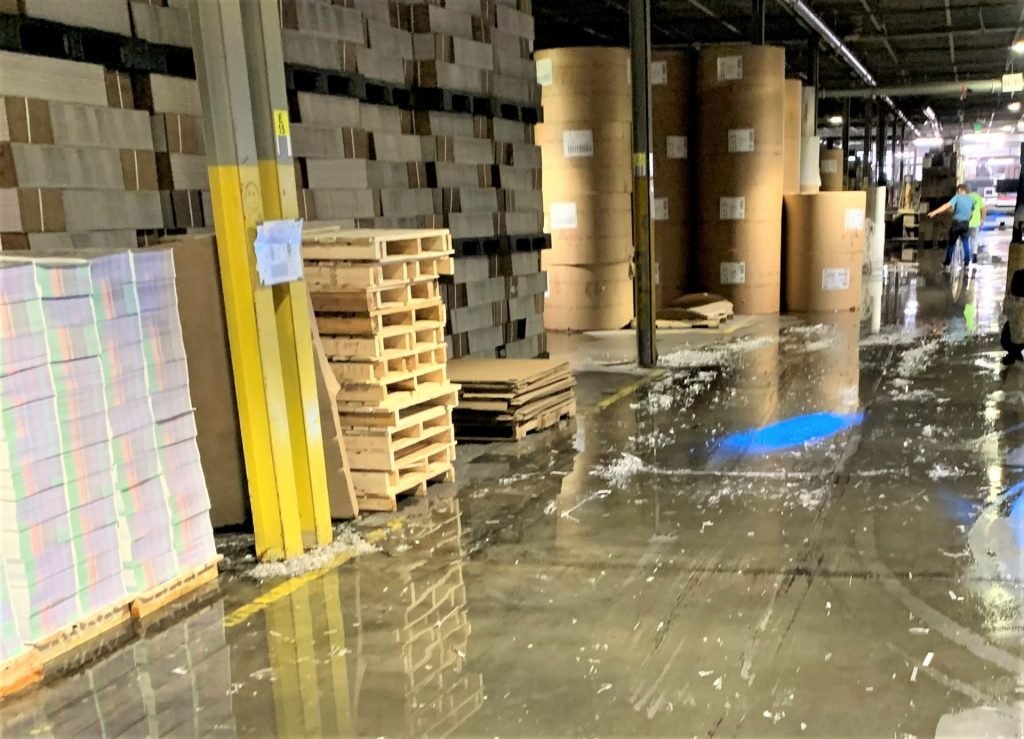 paper products industrial manufacturing facility water intrusion flooded 46,000 of its 400,000 square feet